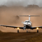 Landing at dirt airfield, Marataba - copyright Wright Photographic
